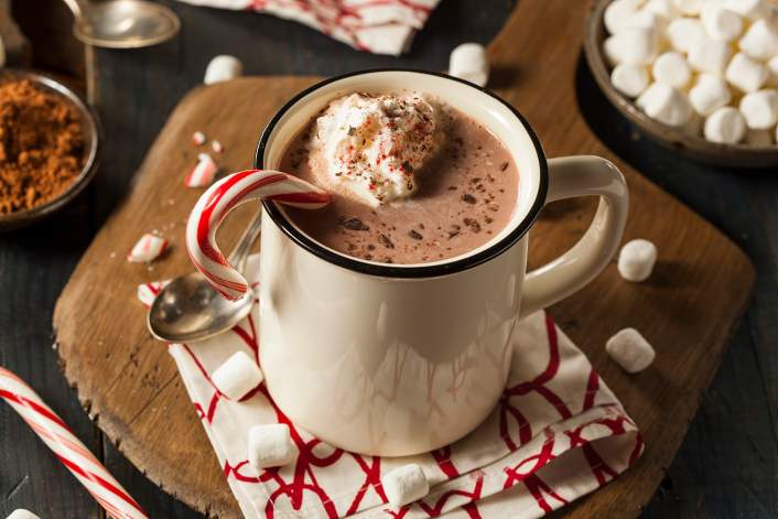 Healthy Peppermint Mocha along side ground coffee and a small pitcher of cream.