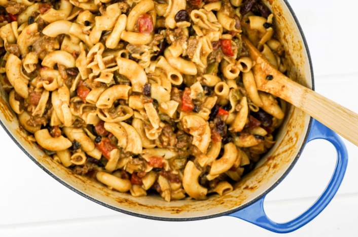 Easy One Pot Chili Mac in a large Dutch oven with pasta, beans, and cheese.