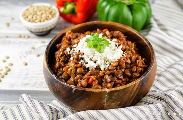Healthy Crockpot recipe for Tuscan lentils in a wooden bowl.