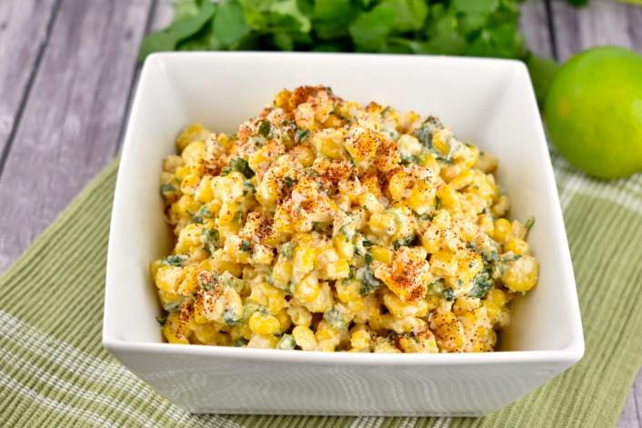 Healthy Mexican Street Corn on a bowl with a green napkin.