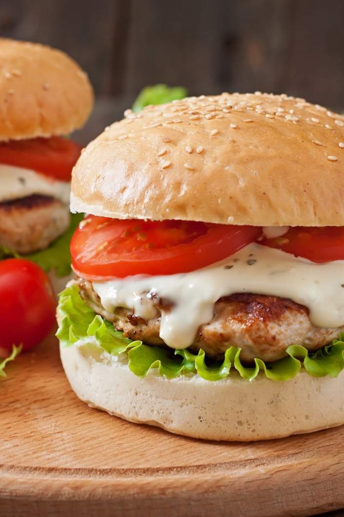 Turkey Ranch Burger with lettuce and tomato on a bun,